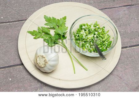 garlic and parsley for spicing food on wooden table