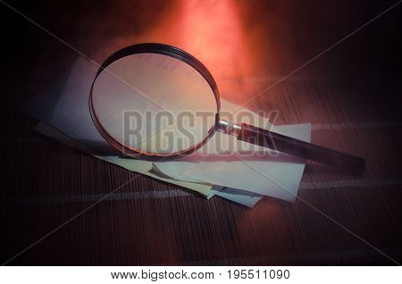 Chinese Abacus And Magnifying Glass, Business Concept On A Dark Background