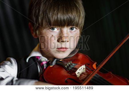 Attractive Boy Playing Violin, Studio Shooting