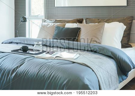 Tray Of Tea Set, Book And Sunglasses Setting On Bed In Modern Classic Style Interior Bedroom