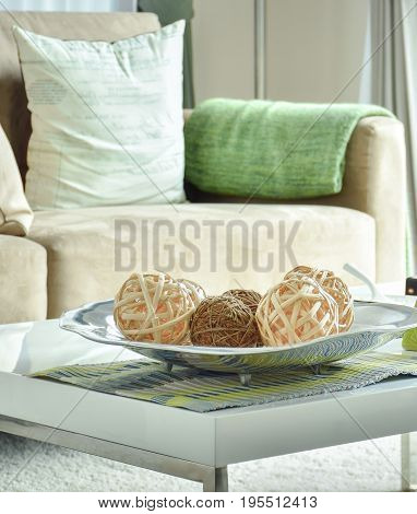 Decorative Rattan Balls On White Top Table With Light Brown Sofa