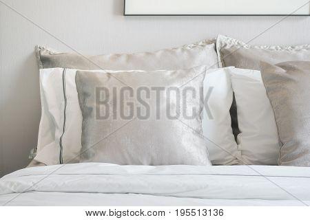 Close Up Light Gray Satin Pillows On Bed