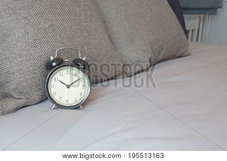 Retro style clock on brown color scheme bedding