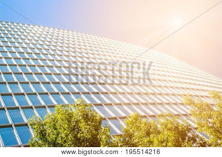 Perspective view of contemporary office building with sun