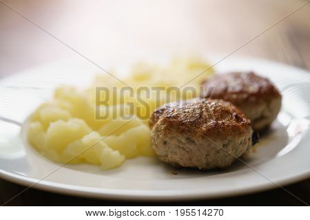 homemade cutlet with mashed potatoes on wood table, shallow focus