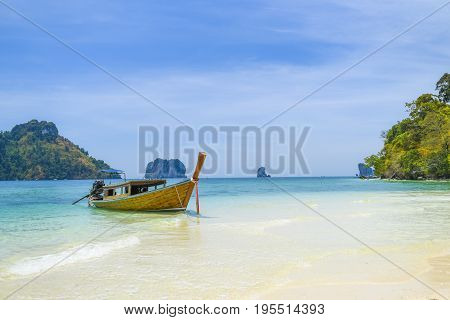 Long tail boat on a tropical island Thailand Andaman sea.