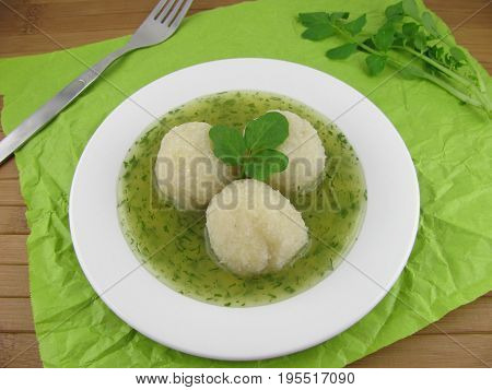 Cooked potato dumplings and tasty watercress sauce