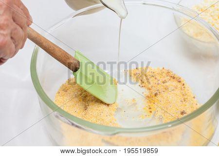 Traditional Colombian Arepa de Choclo Preparation : Adding milk to prepare sweet corn bread