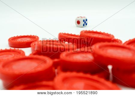 A Pile Of Red Coins And Dice