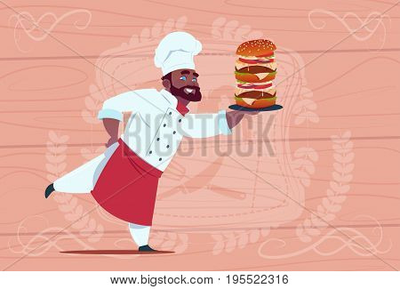 African American Chef Cook Hold Big Burger Smiling Cartoon Restaurant Chief In White Uniform Over Wooden Textured Background Flat Vector Illustration