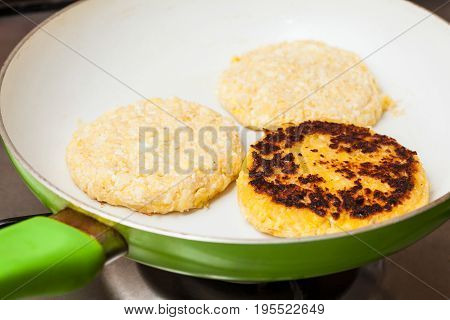 Traditional Colombian Arepa de Choclo Preparation : Cooking the corn bread on a pan