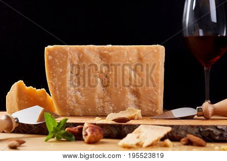 Dutch goat cheese zwart on a wooden board. Cheese and red wine