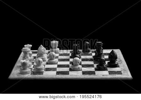 Chess pieces on a chessboard. Chessboard on a black background