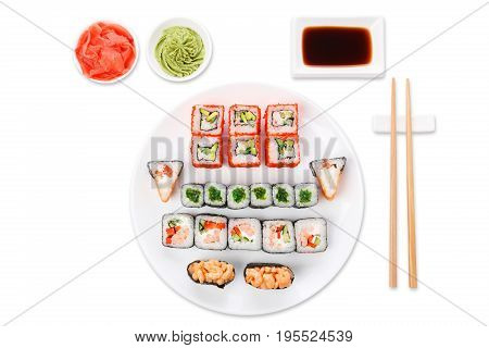 Japanese food restaurant, colorful rolls, gunkan and sushi platter. Set with chopsticks, soy sauce, ginger and wasabi. Top view on white background