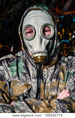 Man Dressed Into Military Wear And Gas Mask, Ecology And Toxic Concept
