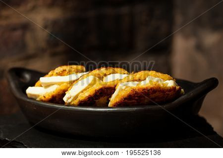 Traditional Colombian Arepa de Choclo Preparation : Arepas de choclo filled with white cheese