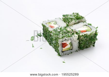 Sushi japanese restaurant delivery. Set of rolls covered with greens and philadelphia cheese inside on white background, closeup, copy space. Healthy food
