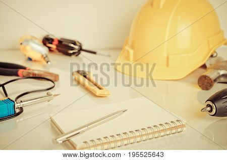 Construction handy man repair tools on white table