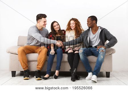 Happy multiethnic friends in casual talking, leisure and party time