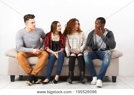 Happy young multiethnic students, friends in casual talking, leisure and party time