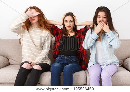 Hear no evil, see no evil, speak no evil, three wise monkey scene showed by young women in casual