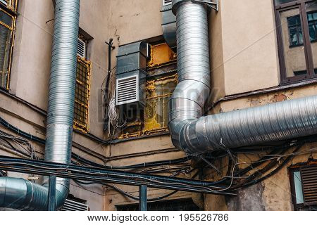 Large vent pipes outside the building, toned
