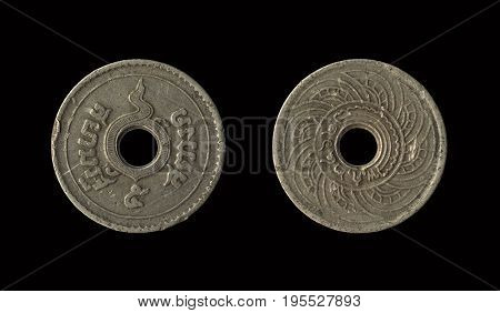 Old coin Thailand which is obsolete today isolated on black background 5 Satang with clipping path
