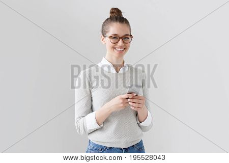 Portrait Of Good-looking College Student Girl Isolated On Grey Background, Looking Right At Camera W