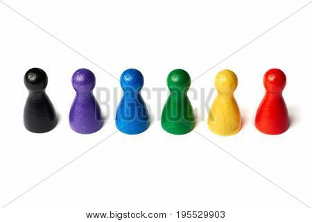 Colorful game figures standing in a row. Concept teamwork, diversity or rainbow colors