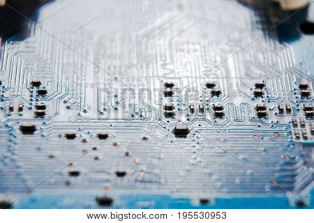 Laptop motherboard microcircuit closeup. Computer electronic parts background, macro