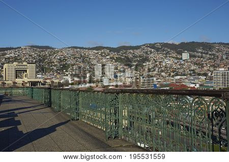 VALPARAISO, CHILE - July 14, 2017: View across the UNESCO World Heritage City of Valparaiso in Chile from Mirador Baron. The large modern building is home to the National Congress of Chile.