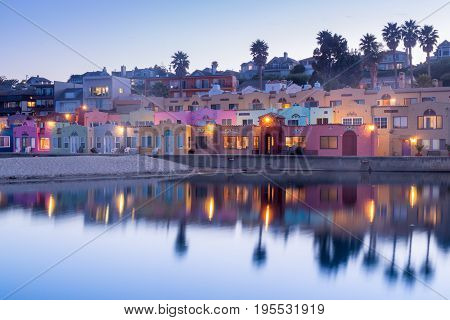 Dusk over Capitola Village. Capitola, Santa Cruz County, California, USA. Mediterranean-style beach houses in Capitola of Santa Cruz County in California.