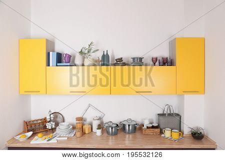Interior of modern kitchen with bright furniture