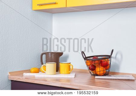 Composition with fruits on counter in kitchen