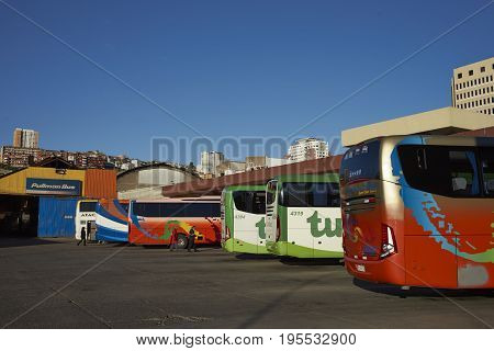 VALPARAISO, CHILE - July 14, 2017: Long distances coaches lined up in the main bus station in the UNESCO World Heritage City of Valparaiso in Chile