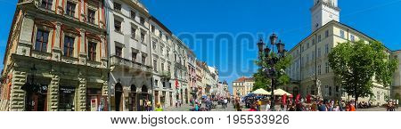 Lviv, Ukraine - May 06, 2017: The panorama of Market Square - the central square of the city Lviv, Ukraine - the people going at Market Square on May 06, 2017