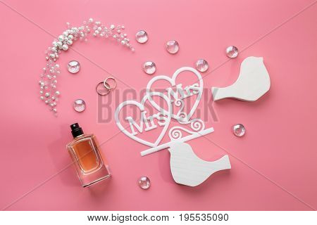 Beautiful composition with rings for lesbian wedding on color background