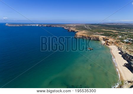 Aerial view of the Tonel Beach (Praia do Tonel) with the Saint Vincent Cape (Cabo de Sao Vincente) on the background in Algarve Portugal