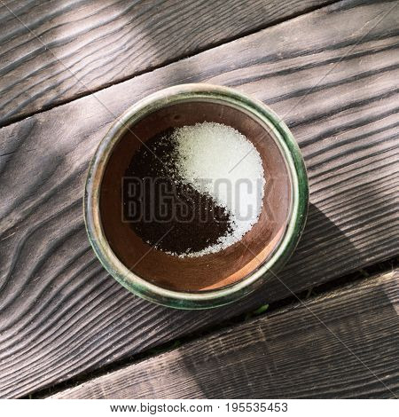 Coffee cup with coffee and sugar in the form of yin and yang