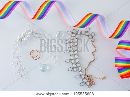 Rings and accessories for lesbian wedding on white background