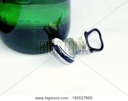 photography with scene of the stopper with beer bottle on white background