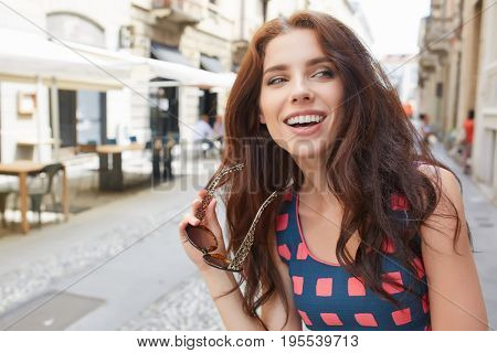 beautiful woman tourist walking and running joyful and cheerful smiling in Tuscany, Italy.