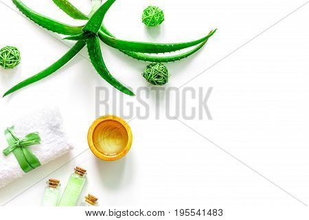 Skin care. Aloe vera gel and aloe vera leafs on white background top view.