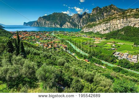 Stunning landscape with Lake Garda and Sarca river near Torbole town Northern Italy Europe