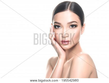Beautiful young asian woman with Clean Fresh Skin on face . Oriental girl Facial  treatment   . Cosmetology , beauty  and spa .