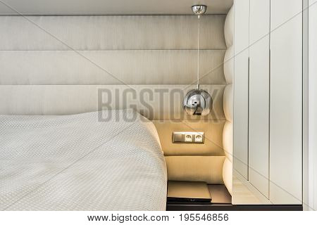 Detail of modern bedroom with silver ball lamp