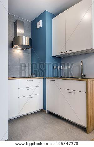 Modern interior design kitchen with blue wall