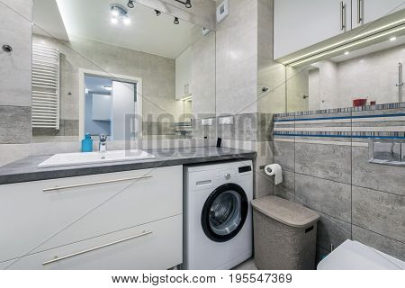 Modern bathroom in bright colors and washer