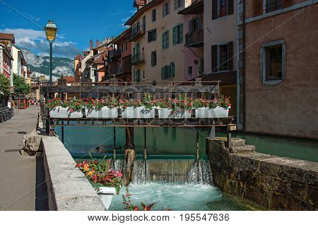 Annecy, France - June 30, 2016. Facade of old and colorful buildings facing the canal, in the city center of historic Annecy, Haute-Savoie department, Auvergne-Rhône-Alpes region, south-eastern France