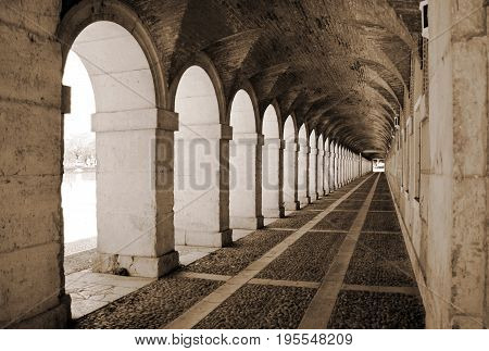 Ancient exterior hallway of Royal Palace in Aranjuez, Spain